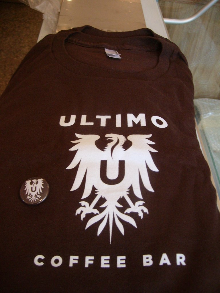 T-Shirt and pin from Ultimo Coffee