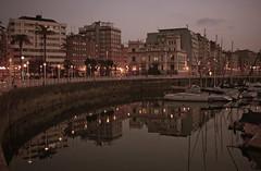 Letargo (Klarii ) Tags: espaa water de luces noche la muelle reina spain agua nikon barcos asturias gijon jardines poniente d40