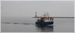 Trip to Warnemünde 01 05-03-09 (stefanspy (38)) Tags: boats warnemünde village fishermen ships balticsea warnow canoneos450d tamronaf1750128