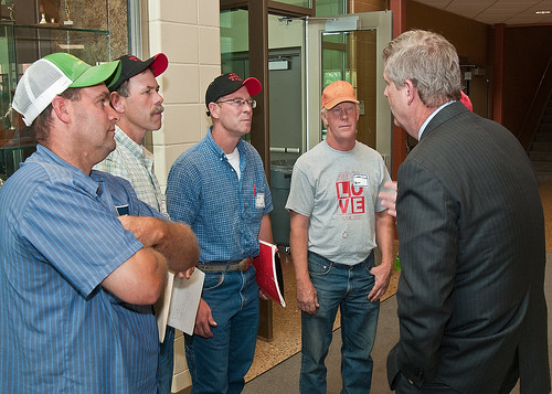 From left: Farmers Steve Roth, Done Rief, Dale Rief, Clifford Dilts discuss topics covered during a town hall meeting with Agriculture Secretary Tom Vilsack at the Glenwood Community High School in Glenwood, Iowa on Thursday, June 16, 2011. Farmers, local and regional media listened and questioned Secretary Vilsack on the cause of the floodwaters along the Missouri River affecting Iowa and Nebraska. Secretary Vilsack offered advice and assistance available through the United States Department of Agriculture and other federal agencies.