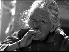 old lady from Patan(Nepal), smoking (Sukanto Debnath) Tags: old nepal portrait bw white black face lady hair asian nose grey cigarette sony smoking ring aged ethnic patan f828 wrinkle nepali debnath sukanto sukantodebnath