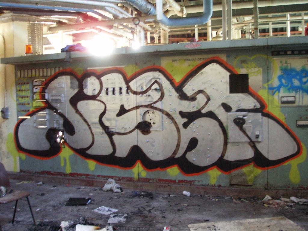 Picture 007 rain coats tags bridge ireland irish abandoned wall switch graffiti factory