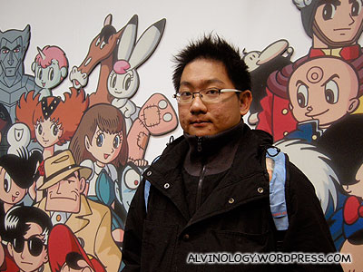 Me with Tezuka Osamu created anime and manga characters as backdrop