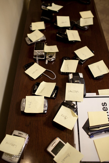 Blackberrys, cell phones and communications devices are tagged with post-its during a briefing on Afghanistan and Pakistan in the Cabinet Room of the White House, March 26, 2009. (Official White House Photo by Pete Souza)