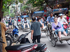 Pushing the tourists through the thick of it... (Antropoturista) Tags: tourists vietnam pedestrians hanoi motorbikes trafic poussepousse