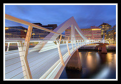Squiggly Bridge (Kit Downey) Tags: city longexposure bridge urban water architecture modern night canon scotland riverclyde clyde cityscape waterfront riverside glasgow bluehour iconic squiggly modernarchitecture citycentre hdr afterdark clydeside glasgowbridge 400d rebelxti hdratnight hdrscotland tradestonbridge squigglybridge lirodon bridgesinscotland squiglybridge kitdowney
