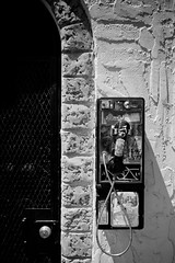 Antique (Jeremy Brooks) Tags: sanfrancisco california door blackandwhite bw usa blackwhite phone telephone payphone missiondistrict themission sanfranciscocounty