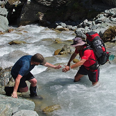 Helping hand (Tomas Sobek) Tags: park newzealand party people west water outdoors coast support stream hiking fast safety mount boulders help national experience strong tramping rivercrossing rushing aspiring rockburn camaraderie offtrack