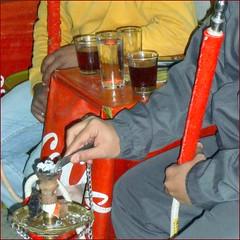 Smoking a Shisha (Arabic: شيشة) in a Hookah lounge  مقهى by Ginas Pics