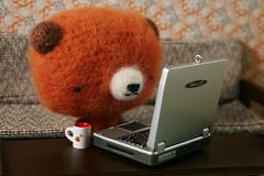 It says here that there is a wild grizzly bear on the loose... (TADA's Revolution) Tags: bear computer miniature panda handmade oneofakind ooak laptop crochet craft plush livingroom sofa softie stuffedanimal kawaii atv rement amigurumi diorama crafting dollhouse stuffie megahouse  whipupcalendar2010
