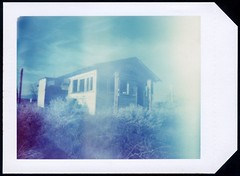 Pinhole Polaroid House (roostercoupon) Tags: california ca wood trip travel blue 2002 light house color abandoned film polaroid back long exposure pin hole decay empty large 7 shift pinhole valley antelope type instant 4x5 format shelter leak expired effect mecca pox seconds 59 holder timed 545i 72mm f120