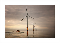 Morning Calm (Ian Bramham) Tags: morning light england mist industry water station yellow photography boat photo nikon energy power wind farm offshore fineart calm explore electricity northern barrow windfarm renewable renewableenergy centrica barrowinfurness d40 dongenergy ianbramham gettyimagegallerytakenote