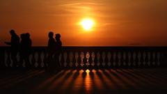 ... siamo tutti di passaggio (FranK.Dip) Tags: desktop sunset wallpaper people canon tramonto mare gente persone sole colori livorno orizzonte passeggio sfondo sfondi passaggio spettacolare terrazzamascagni eos450d dip2 frankdip 05172009