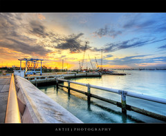 Sunrise @ Marina Barrage, Singapore :: HDR (Artie | Photography :: I'm a lazy boy :)) Tags: sea water clouds marina photoshop sunrise canon construction singapore cs2 pipes wideangle cranes equipment handheld 1020mm constructionsite railings barrage hdr artie 3xp sigmalens photomatix tonemapping tonemap 400d marinabarrage rebelxti machineries