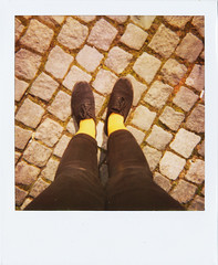 A pair of yellow socks (Tuva Moen Holm) Tags: norway polaroid foot norge spring shoes oldschool cobblestone lookingdown trondheim sko fot vr retrostyle brostein yellowsocks inmyownshoes savepolaroid gulesokker