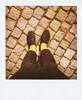 A pair of yellow socks (Tuva Moen Holm) Tags: norway polaroid foot norge spring shoes oldschool cobblestone lookingdown trondheim sko fot vår retrostyle brostein yellowsocks inmyownshoes savepolaroid gulesokker