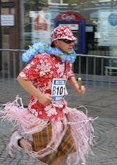 Hawaii Has Come To Elgin (Craigfaelossie) Tags: street flowers portrait man hat st shirt fun hawaii scotland high dress action marathon bank running run skirt giles elgin jogging raf moray morayshire kinloss marafun plainstones