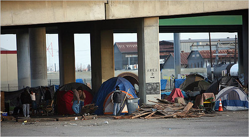 Tents under an overpass in a Fresno, California rail yard. Homelessness in Fresno has long been fed by the ups and downs in seasonal and subsistence jobs in agriculture, but the recession has cast a wider net and drawn hundreds of newly homeless. by Pan-African News Wire File Photos