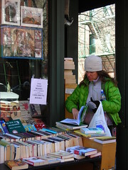 bookbuyer (omoo) Tags: newyorkcity woman girl corner reading looking westvillage bookstore storefront biography greenwichvillage buying discounted salebooks remaindered biographybookshop bleeckerstreetatwest11thstreet greenquiltedjacket outsidesalestable excessinventory