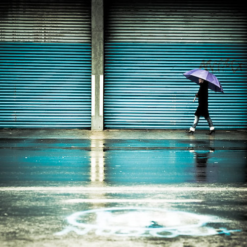 Blue / rain / reflection / urban / graffiti / umbrella / walking / woman / street photography