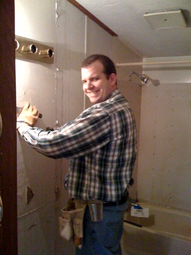 David tearing out the bathroom
