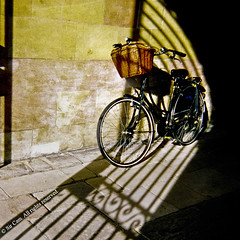 Clare Bicycle (Sir Cam) Tags: camera cambridge light film gate university shadows disposable clarecollege sircam