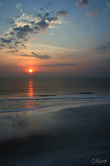 Daytona Memories (FLPhotonut) Tags: sea beach clouds sunrise reflections sand surf daytona canonrebelxt cloudscapes sigma1770 bej flphotonut mmmilikeit