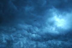 perilous (DJ Axis) Tags: sky storm clouds plane dark gris montral evil stormy ciel sombre thunderstorm nuages orage avion obscure mchant mammatus couvrir tnbreux orageux