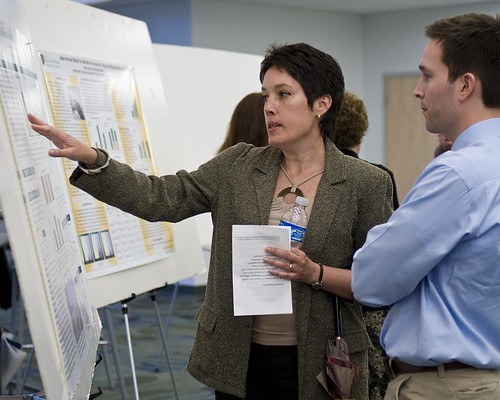 Faculty development director Patricia Hudes discusses poster design with medical student Nathan Weir at the Medical Student Research Symposium on May 1. Nathan won an award for Best Design and Method at the symposium. [Photo by Will Jones/WSU Center for Teaching and Learning]