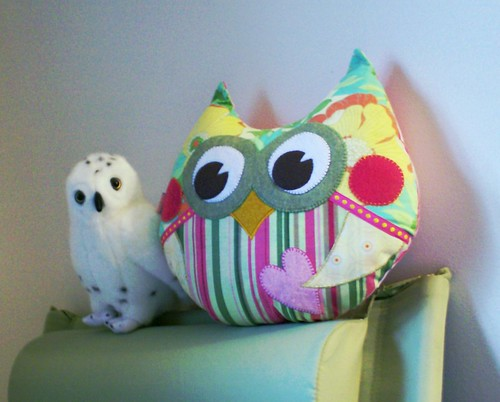 Stuffed realistic snowy owl and cute kawaii handmade sewn stylized owl plushie