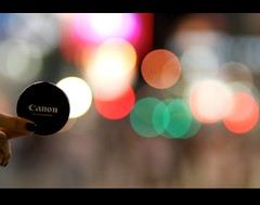 You can Canon. (Explore) (goodbyebyesunday) Tags: light night canon bokeh finger lenscap 85mmf18 primelens bokehlicious carolshand
