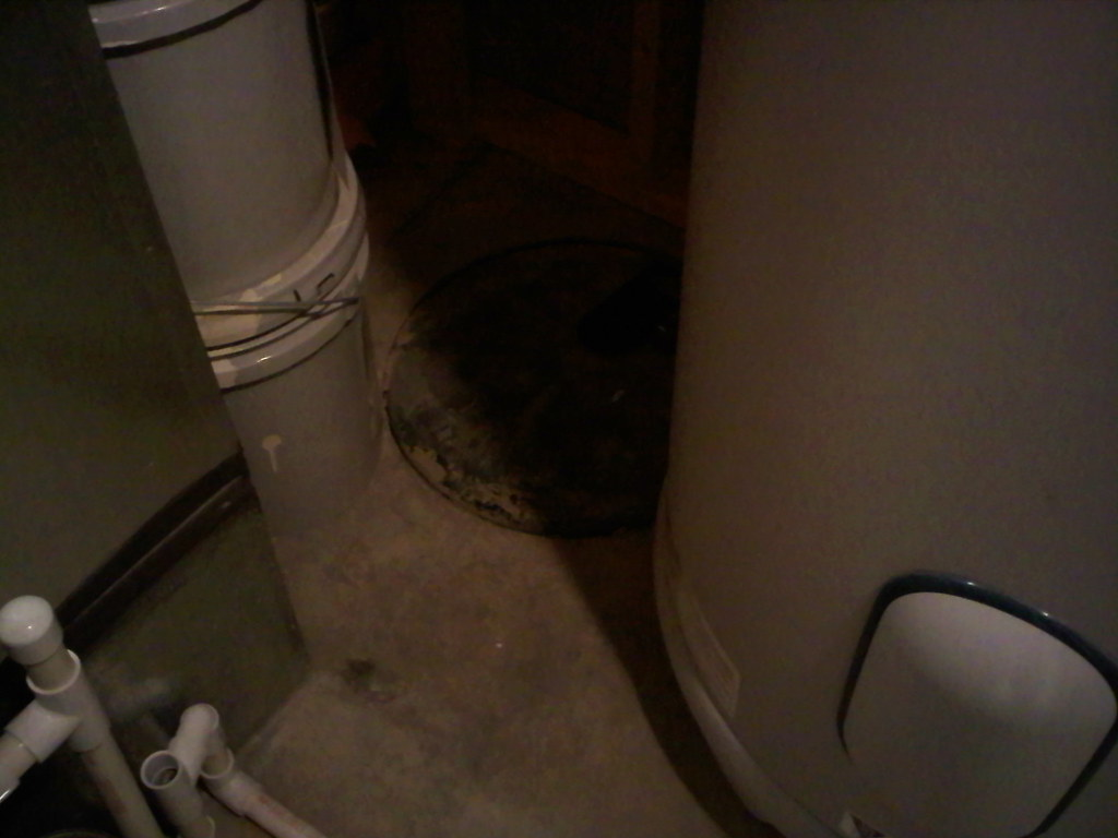 Behind Waterheater (In Utility Room)