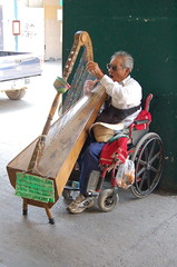 A blind harpist, Mexico (AndrewGould) Tags: mexico blind wheelchair harp cholula harpist