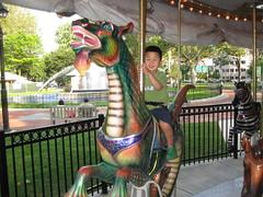 Owen riding on the dragon