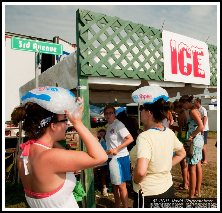 Reddy Ice - Girls Wearing Ice Bag Hats - 2010 Bonnaroo Music Festival Photos - © 2011 David Oppenheimer