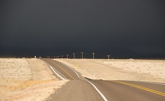 storm approaching in new mexico desert by hannu & hannele - near raton in northeastern new mexico