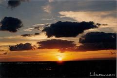 Sunrise over Lake Killarny (Rashad Penn) Tags: morning blue shadow red sky orange sun clouds dark day break horizon rise bahamas nassau