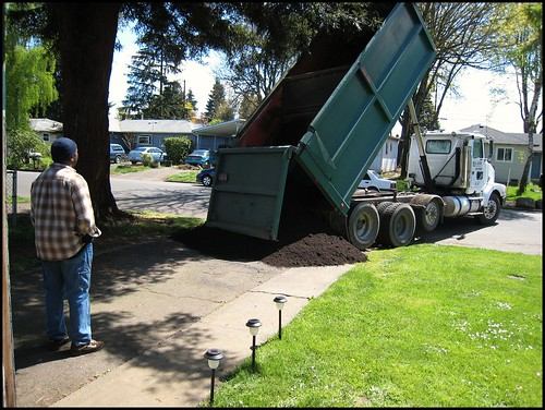 Dumping the soil in our driveway