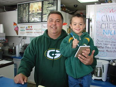 Tim Nassiopoulos with his godson and helper Lukas Grabowski. Nassiopoulos owns and operates The Gyros Stand at 1110 E. Oklahoma Ave. Prior to 1989, Dennis' Dairy Treats occupied the building.          —photo Michael Timm