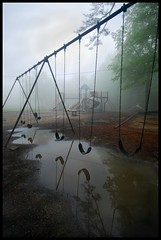 No Recess. (BamaWester) Tags: reflection rain playground fog puddle swingset montesano bamawester napg artlibres norecess