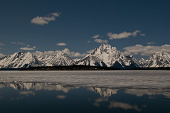 Jackson Lake Reflections (idashum) Tags: blue cloud mountain lake snow ice nature reflections landscape frozen nationalpark nikon unitedstates jackson explore wyoming mountmoran tetons moran range grandteton grandtetonnationalpark d300 jacksonlake explored