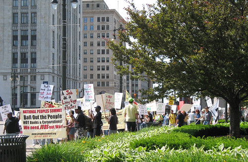 People's Summit participants line-up outside Grand Circus Park in downtown Detroit for a march on GM World Headquarters on June 15, 2009. The Summit demanded full-employment in the US. (Photo: Alan Pollock) by Pan-African News Wire File Photos