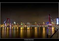Willemsbrug (Part1) - Rotterdam (DolliaSH) Tags: city longexposure bridge light urban haven holland color water colors architecture night photoshop canon reflections river puente photography eos lights noche photo rotterdam europe foto nightshot photos nacht harbour nederland thenetherlands wideangle ponte most adobe le pont brug maas brcke ultrawide nuit soe efs 1022mm notte hdr stad noch brucke cs4 photomatix 50d supershot tonemapping nachtopname canon50d detailsenhancer dollia dollias sheombar