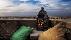 Overlooking the desert (momentaryawe.com) Tags: lamp hotel dubai traditional uae resort pillows arabic emirates hdr babalshams d300 majilis