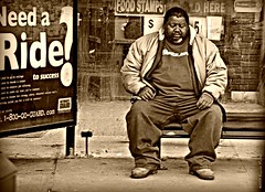 Hard Times (Flicasso) Tags: people man bus male guy sepia bench person nikon king sitting sad streetphotography busstop mad hardtimes 18200mm d80 nikond80 rawstreetphotography photokalye newenglandstreetphotography guerrillastreetphotography