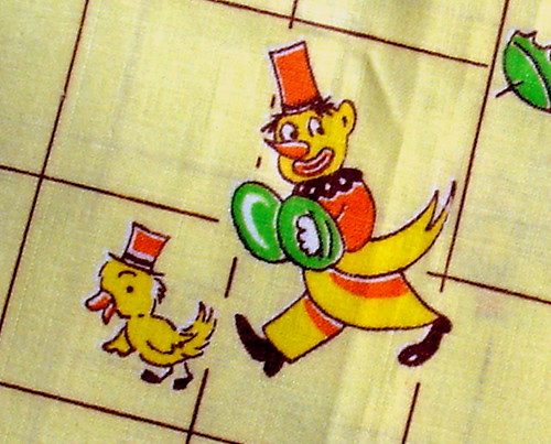 fabric with clown antagonizing a duck