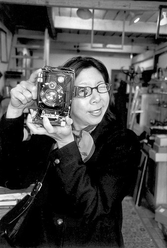 Pammy with old camera at the Porte de Clignancourt flea market