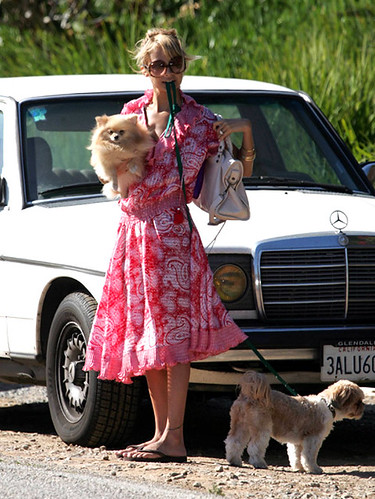 Nicole Richie wearing red paisley print vintage Diane Fres dress while