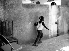 Girl Running (LOVE_LensOfVision&Expression) Tags: children creativity photography haiti orphanage cameras developingcountry plantingpeace humancondition portauprince globalpoverty photographyworkshop thirdworldcountry nonforprofit lovelensofvisionexpression projectpapillon