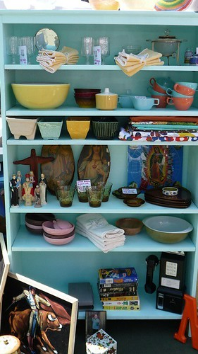 Wonderful aqua shelves filled with vintage goods
